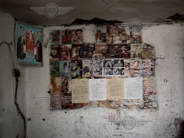 Pictures cut from fashion magazines and notices pasted on a wall at the Navagrodovskaya coal mine, West Donetsk.