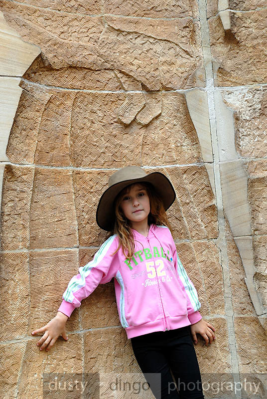 Child (6 years old) standing by sandstone sculpture depicting early free-settlers, by Bud Dumas. The Rocks, Sydney, Australia