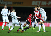 2nd December 2017, Griffen Park, Brentford, London; EFL Championship football, Brentford versus Fulham; Ollie Watkins of Brentford is challenged by Oliver Norwood of Fulham and Tom Cairney of Fulham