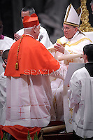 German cardinal Gerhard Ludwig Muller receives his beret as he is being appointed cardinal by Pope Francis  at the consistory in the St. Peter's Basilica at the Vatican on February 22, 2014.