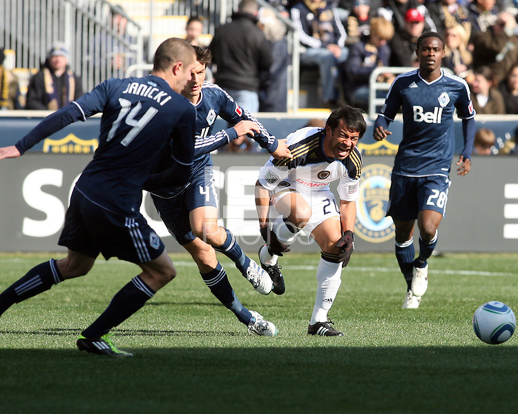 Carlos Ruiz#20 of the Philadelphia Union is fouled by Alain Rochat#4 of the Vancouver Whitecaps during an MLS match at PPL Park in Chester, PA. on March 26 2011. Union won 1-0.