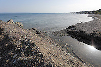 Pictured: A stream, believed to be the same one running past the second site where a search took place, ends up in the sea in Kos, Greece. Monday 17 October 2016<br />