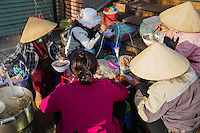 Pho Stall at Dalat Market - Whether it is day or night, a steaming bowl of pho noodles is always available in Vietnam.  This al fresco pho stall at Dalat Market caters to local vendors who are enjoying a noodle break.