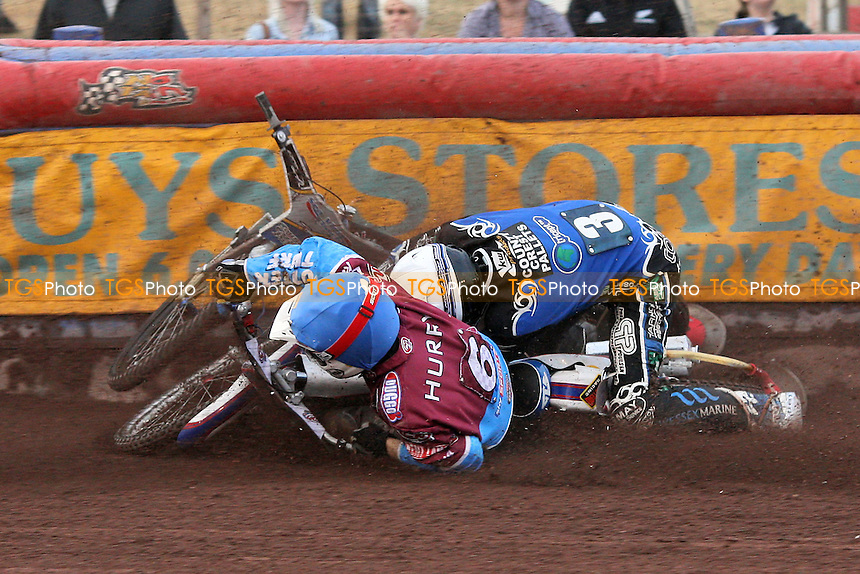 Heat 7: Paul Hurry (blue) crashes out with Bjarne Pedersen - Lakeside Hammers vs Poole Pirates - Sky Sports Elite League Speedway at Arena Essex Raceway, Purfleet, Essex - 02/08/10 - MANDATORY CREDIT: Gavin Ellis/TGSPHOTO - Self billing applies where appropriate - Tel: 0845 094 6026