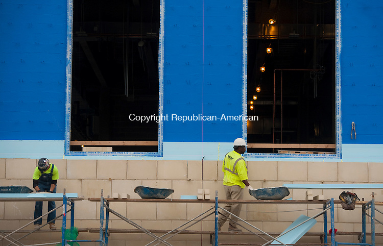 TORRINGTON, CT--- -102115JS02---Workers install stone facing to the building as construction continues on the new Litchfield County Courthouse on Freight Street in Torrington on Wednesday.<br /> Jim Shannon Republican-American