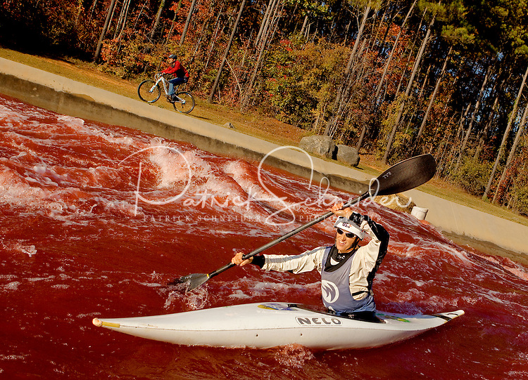 Halloween festivities turn the whitewater rapids blood red at the US National Whitewater Center in Charlotte, NC. The USNWC, an ultimate adventure playground for outdoor enthusiasts, offers both water and land sports.