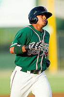 Greensboro Grasshoppers center fielder Jesus Solorzano (12) rounds the bases after hitting a home run against the Kannapolis Intimidators at CMC-Northeast Stadium on July 12, 2013 in Kannapolis, North Carolina.  The Grasshoppers defeated the Intimidators 2-1.   (Brian Westerholt/Four Seam Images)