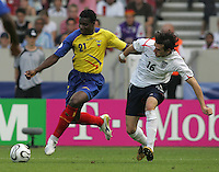 English midfielder (16) Owen Hargreaves movies in on Ecuadorian forward (21) Carlos Tenorio.  England defeated Ecuador, 1-0, in their FIFA World Cup round of 16 match at Gottlieb-Daimler-Stadion in Stuttgart, Germany, June 25, 2006.