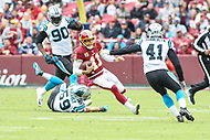 Landover, MD - October 14, 2018: Washington Redskins quarterback Alex Smith (11) runs the ball during the  game between Carolina Panthers and Washington Redskins at FedEx Field in Landover, MD.   (Photo by Elliott Brown/Media Images International)