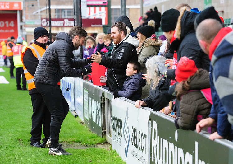 Lincoln City's assistant manager Nicky Cowley with fans at the end of the game<br /> <br /> Photographer Chris Vaughan/CameraSport<br /> <br /> The EFL Sky Bet League Two - Lincoln City v Grimsby Town - Saturday 19 January 2019 - Sincil Bank - Lincoln<br /> <br /> World Copyright &copy; 2019 CameraSport. All rights reserved. 43 Linden Ave. Countesthorpe. Leicester. England. LE8 5PG - Tel: +44 (0) 116 277 4147 - admin@camerasport.com - www.camerasport.com