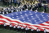 SEATTLE, WA - SEPTEMBER 16:  Washington band members held the flag during the National Anthem before the game between the Washington Huskies and the Fresno State Bulldogs on September 16, 2017 at Husky Stadium in Seattle, WA. Washington won 63-7 over Montana.