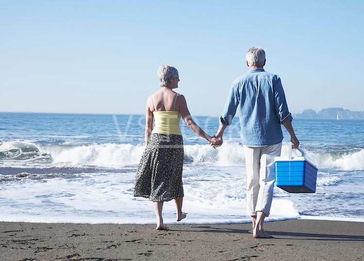 USA, California, Fairfax, Rear view of mature couple walking on beach