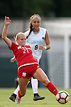 16 September 2016: NC State's Paige Griffiths (21) and North Carolina's Abby Elinsky. The University of North Carolina Tar Heels hosted the North Carolina State University Wolfpack in a 2016 NCAA Division I Women's Soccer match. NC State won the game 1-0.