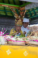 Jatiluwih, Bali, Indonesia.  Hindu Priest Praying over Offerings, Luhur Bhujangga Waisnawa Hindu Temple.