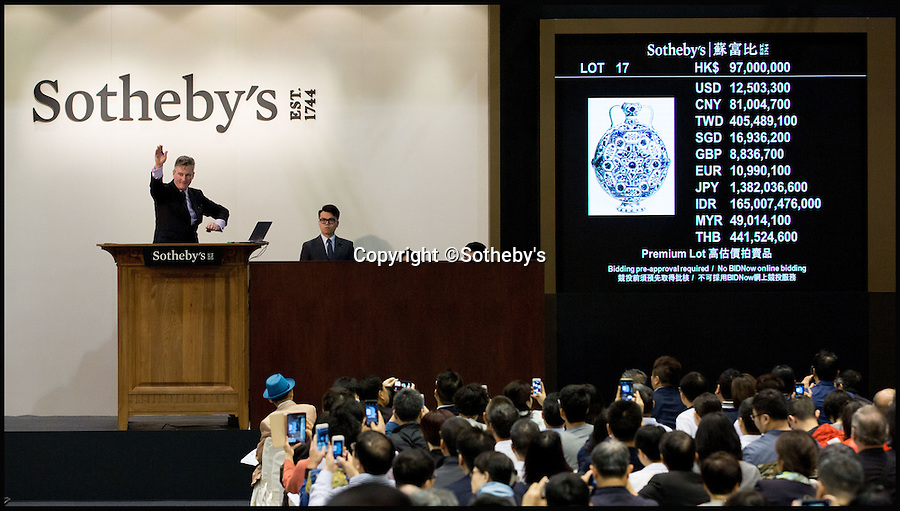BNPS.co.uk (01202 558833)<br /> Pic: Sothebys/BNPS<br /> <br /> Hammer comes down on the &pound;10.1 million Moonflask.<br /> <br /> A collection of Chinese antiques that a farmer paid as little as &pound;100 per item for has sold for a whopping &pound;45.9 million.<br /> <br /> The late Roger Pilkington accumulated about 100 pieces of exquisite Chinese ceramics in the late 1950s and early '60s <br /> <br /> He died in 1969 aged just 40. His 'time capsule' collection has remained in his family ever since and they have now sold it at auction.<br /> <br /> Leading the sale was a 9ins tall 15th century blue and white Moon Flask which sold for a &pound;10.1m.