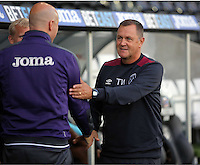Pictured L-R: Swansea coach Cameron Toshack greets West Ham United coach Terry Westley Friday 26 August 2016<br />