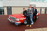 Pictured: Swansea City footballers Leon Britton and Garry Monk in a genuine film car from Starsky and Hutch, a mid seventies Ford Gran Torino at Libery Stadium, Swansea. South Wales. Thursday 04 December 2008.<br />