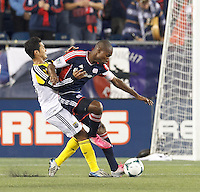 Columbus Crew forward Jairo Arrieta (25) and New England Revolution defender Jose Goncalves (23) battle for the ball.  In a Major League Soccer (MLS) match, the New England Revolution (blue) defeated Columbus Crew (white), 3-2, at Gillette Stadium on October 19, 2013.