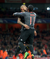 Arturo Vidal of Bayern Munich celebrates with Douglas Costa of Bayern Munich after scoring their 4th goal to make it 1-4 during the UEFA Champions League round of 16 match between Arsenal and Bayern Munich at the Emirates Stadium, London, England on 7 March 2017. Photo by Alan  Stanford / PRiME Media Images.