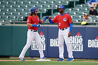 Buffalo Bisons Bo Bichette (13) fist bumps first base coach Devon White (22) after hitting a single during an International League game against the Indianapolis Indians on June 20, 2019 at Sahlen Field in Buffalo, New York.  Buffalo defeated Indianapolis 11-8  (Mike Janes/Four Seam Images)