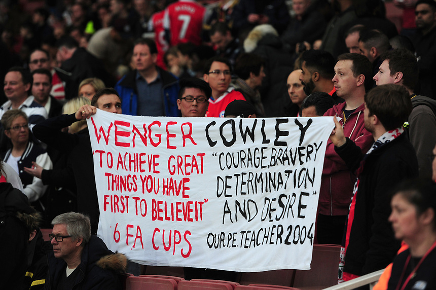 Spectators hold a banner comparing quotes between Arsenal manager Arsene Wenger and Lincoln City manager Danny Cowley <br /> <br /> Photographer Chris Vaughan/CameraSport<br /> <br /> The Emirates FA Cup Quarter-Final - Arsenal v Lincoln City - Saturday 11th March 2017 - The Emirates - London<br />  <br /> World Copyright &copy; 2017 CameraSport. All rights reserved. 43 Linden Ave. Countesthorpe. Leicester. England. LE8 5PG - Tel: +44 (0) 116 277 4147 - admin@camerasport.com - www.camerasport.com