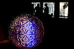 A replica of the New Year's Eve Ball is seen on the reception building where the Original ball is set up for celebrations on New Year Eve 2012 in New York City. 12/30/11.  Photo by Eduardo Munoz Alvarez / VIEWpress.