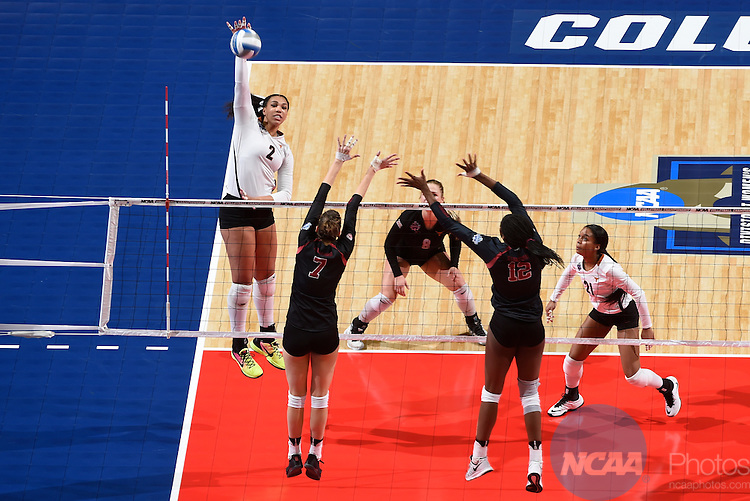 COLUMBUS, OH - DECEMBER 17:  Ebony Nwanebu (2) of the University of Texas hits a kill against Stanford University during the Division I Women's Volleyball Championship held at Nationwide Arena on December 17, 2016 in Columbus, Ohio.  Stanford defeated Texas 3-1 to win the national title. (Photo by Jamie Schwaberow/NCAA Photos via Getty Images)