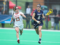 College Park, MD - May 19, 2018: Navy Sarah Childress (2) runs past Maryland Terrapins Megan Whittle (23) during the quarterfinal game between Navy and Maryland at  Field Hockey and Lacrosse Complex in College Park, MD.  (Photo by Elliott Brown/Media Images International)