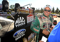Nov 14, 2010; Pomona, CA, USA; NHRA funny car driver John Force after winning in the first round during the Auto Club Finals at Auto Club Raceway at Pomona. Mandatory Credit: Mark J. Rebilas-