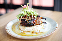STAMFORD, CT - July 17, 2014: Grilled Double Cut Pork Chop at Paloma. CREDIT: Clay Williams for Paloma.<br /> <br /> &copy; Clay Williams / http://claywilliamsphoto.com