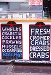AMHJF8 Chalk writing on blackboard crabs and seafood Cromer Norfolk England
