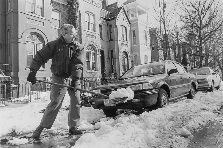 Mel Zinter of Capitol Hill and neighbor of delegate Rep. Eleanor Holmes Norton, D-D.C., shoveling snow from around his car. He said you could move your car and everything was fine 'till the street was plowed' in February 1994. (Photo by Maureen Keating/CQ Roll Call via Getty Images)