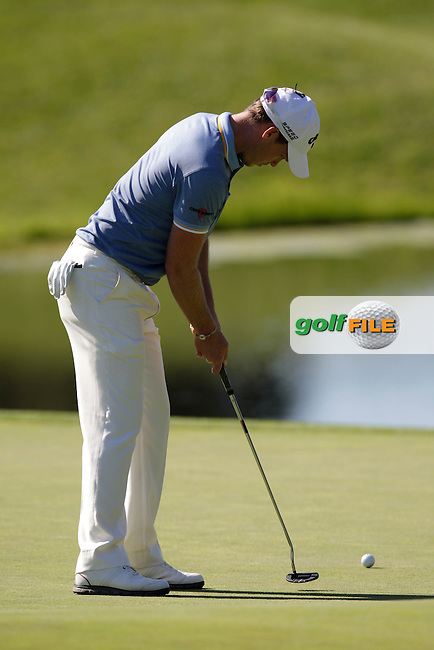 Danny Willett (ENG) takes his putt on the 4th green during Thursday's Round 1 of the 2014 Open de Espana held at the PGA Catalunya Resort, Girona, Spain. Wednesday 15th May 2014.<br /> Picture: Eoin Clarke www.golffile.ie