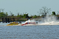 Frame 4: Terry Rinker (#10) and Chris Fairchild (#62) race up the back stright to turn 2 where Rinker's boat rolls over a wake, noses in and flips.   (Formula 1/F1/Champ class)