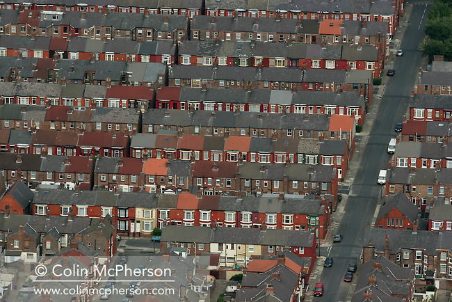 A photograph showing typical working class houses in Liverpool.  Liverpool, with a population of around 750,000, is one of the most important cities in north west England famous for its docks and maritime heritage and as birthplace of the Beatles..Photograph © Colin McPherson, 01/07/06..Tel. +44 (0)7831 838717..Email: mail@colinmcpherson.co.uk