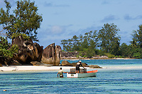 Seychelles, Island Mahe, Anse l'Islette: fishermen at work and Island Petite Ile