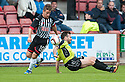 Stranraer's Mark Corcoran is easily brushed off the ball by Pars' Josh Falkingham.