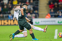 Sergio Aguero of Manchester City scores his side's fourth goal under pressure from Alfie Mawson of Swansea during the EPL - Premier League match between Swansea City and Manchester City at the Liberty Stadium, Swansea, Wales on 13 December 2017. Photo by Mark  Hawkins / PRiME Media Images.
