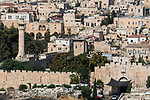 The round tower of Bab Al-Asbat Minaret, the Lions' Gate or St. Stephen's Gate and the Muslim Quarter in the Old City of Jerusalem.  The Old City of Jerusalem and its Walls is a UNESCO World Heritage Site.