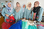 Several students in an advanced dressmaking class pose in their classroom in the Vocational Training Center in Gaza City, Gaza. The center is sponsored by the Department of Service for Palestinian Refugees of the Near East Council of Churches, and funded in part by the Pontifical Mission for Palestine. DSPR is a member of the ACT Alliance.