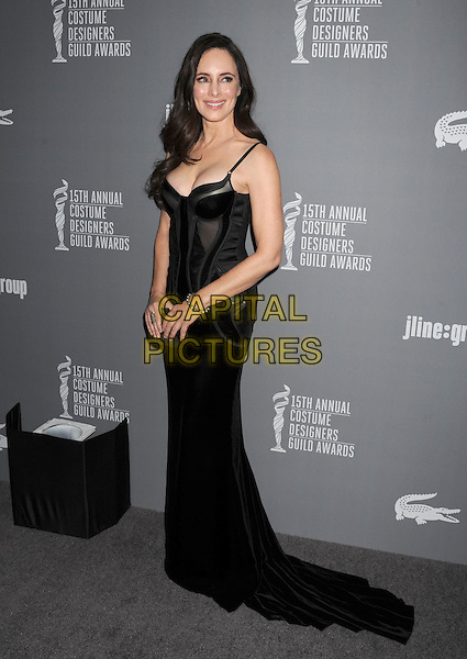 Madeleine Stowe.15th Annual Costume Designers Guild Awards held at the Beverly Hilton Hotel, Beverly Hills, California, USA..February 19th, 2013.full length dress clutch bag cleavage corset black.CAP/ROT/TM.© TM/Roth/Capital Pictures