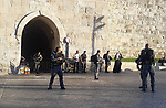 Israeli police block the gates of al-Aqsa mosque after a stabbing attack next to one of the al-Aqsa Mosque compound entrances in Jerusalem's Old City, 15 August 2019. Israeli police spokesperson said 'two Palestinians armed with knives carried out a stabbing attack against Israeli policeman guarding at the entrance of the al-Aqsa Mosque'. One policeman was reported to have sustained moderate wounds, and both attackers were shots. Photo by Afif Amera / WAFA