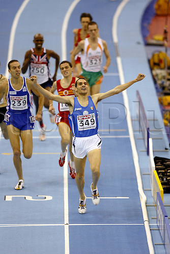 3 March 2007: Italian runner Cosimo Caliandro (ITA) celebrates victory in the Men's 3000m Final at the European Indoor Athletics Championships held at the National Indoor Arena, Birmingham. Photo: Neil Tingle/Actionplus...070303 athletics finish line joy celebration
