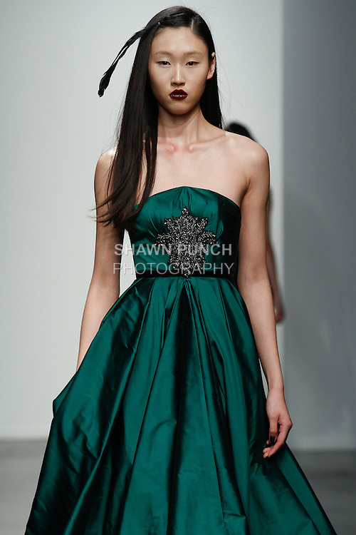 Model walks runway in an outfit from the Philippa Galasso Fall Winter 2014 collection, at Fashion Palette New York Fall Winter 2014/2015; during New York Fashion Week Fall 2014, on February 11, 2014.