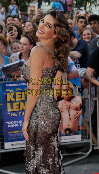 Kelly Brook.'Keith Lemon: The Film' Premiere, Odeon West End cinema, Leicester Square, London, England..20th August 2012.half length grey gray black sparkly one shoulder dress side looking over shoulder lace.CAP/WIZ.© Wizard/Capital Pictures.