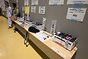 Saitama, Japan - A photo made available on March 22, 2011 shows a mobile phone charging stand available for the evacuees staying at Saitama Super Arena, a temporary shelter in Saitama, north of Tokyo. Thousands of residents from Fukushima evacuated their town as high levels of radiation continued to be a high risk from the quake-hit nuclear plant. (Photo by Christopher Jue/Nippon News/AFLO)