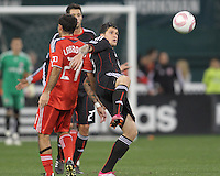 Santino Quaranta #25 of D.C. United  backs into Nick LaBrocca #21 of Toronto FC during an MLS match that was the final appearance of D.C. United's Jaime Moreno at RFK Stadium, in Washington D.C. on October 23, 2010. Toronto won 3-2.