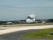 Space Shuttle Discovery taxis on the back of the Shuttle Carrier Aircraft as it arrives at Washington Dulles International Airport in Virginia after its final flight from the Kennedy Space Center in Florida on Tuesday, April 17, 2012.  Discovery will be on permanent display at the  Smithsonian Institution's Steven F. Udvar-Hazy Center in Chantilly, Virginia..Credit: Ron Sachs / CNP.(RESTRICTION: NO New York or New Jersey Newspapers or newspapers within a 75 mile radius of New York City)