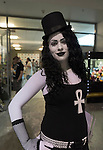 Garden City, New York, U.S. - June 14, 2014 - ADRIENNE LOJECK, of Port Jefferson, is dressed in black and white as Death from Sandman comic books by Neil gaiman, at Eternal Con, the annual Pop Culture Expo, with costumes, Comic Books, Collectibles, Gaming, Sci-Fi, Cosplay, Horror, and held at the Cradle of Aviation Museum on Long Island. A white ankh, a symbol for life, is on her shirt.