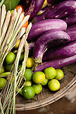VIETNAM, Hue, an assortment of limes, eggplants and onions at a rural roadside market